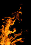 Bright flame in corner on black Stock Images