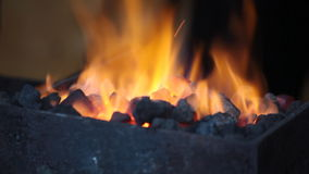 Bright flame of fire burns in a forge horn stock video footage