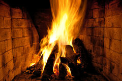 Bright flame of fire the fireplace Stock Photography