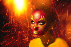 Bright flamy fairy lady. Fantasy make-up stock images