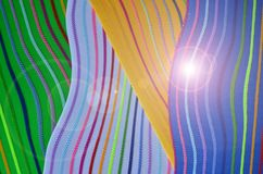 Bright flare on beautiful curve line pattern. Bright flare on beautiful rainbow color curve line pattern top view royalty free stock photography