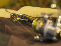 Bright float, fishing reel and rod Stock Images
