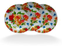 Bright floral decorated dish plates Royalty Free Stock Photography