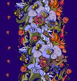 Bright floral ornamental in frieze of garden flowers. In violet, purple, orange, green, blue and pink a seamless pattern on a dark blue background Royalty Free Stock Images