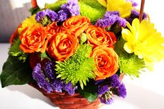 Bright flower arrangement (ikebana) in a basket Royalty Free Stock Image