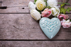 Bright flowers and  decorative heart  on vintage  wooden background Royalty Free Stock Images