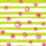 Bright flowers pattern. Bright pink flowers confetti seamless pattern on lime striped background Stock Images