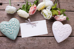 Bright flowers,  white and turquoise decorative hearts  and empt Royalty Free Stock Photography