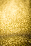 Bright through focus gold abstract bokeh background Stock Images