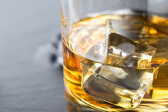 Bright fragment of whiskey with ice in a glass Stock Photo
