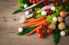 Bright and fresh vegetables on a wooden background. Royalty Free Stock Photography