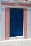 Bright front door in Oia in Santorini.Vertical view stock images