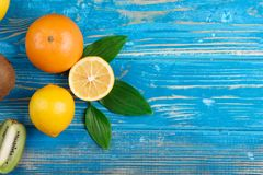 Bright fruit mix on a blue wooden background stock photography