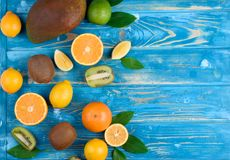Bright fruit mix on a blue wooden background stock photo