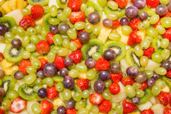 Bright fruit salad background Stock Photo