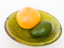 Bright fruits. Fruit avocado,grapefruit green plate Royalty Free Stock Photo