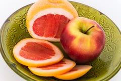 Bright fruits. Fruit grapefruit, Apple green plate Stock Images
