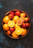 Bright fruits in large tray: oranges, lemons, mango in assortment. View from above royalty free stock images