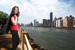 A bright future. Young business woman standing in front of the Manhattan Skyline Royalty Free Stock Image