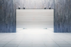 Bright garage with closed door. Front view of bright garage with closed door. 3D Rendering Royalty Free Stock Images