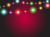 Bright garland lights glowing with various colors. Luminous radi. Ant christmas holiday light decorations. Colorful xmas illumination background Stock Images