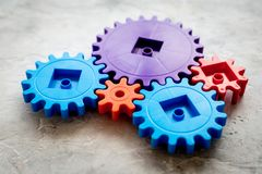 Bright gears for great technology of team work and correct mechanism on stone background Royalty Free Stock Photo