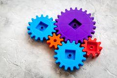 Bright gears for great technology of team work and correct mechanism on stone background Stock Images