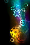 Bright gears. Bright multicolored gears on a dark background Royalty Free Stock Images