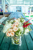 Bright gentle bouqet on the wooden table Royalty Free Stock Image