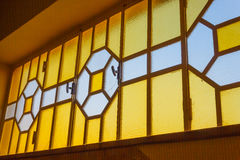 A bright and geometric glass window Stock Photo