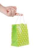 Bright gift bags in hand Stock Image