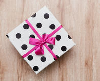 Bright gift box with pink bow Stock Image