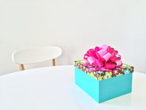 Bright gift box on white table Royalty Free Stock Photo
