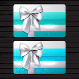 Bright gift cards with silver bow Stock Photos