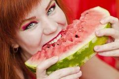 Bright girl enjoying sweet watermelon Royalty Free Stock Image