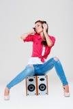 Bright girl with headphones Stock Image