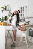 Bright girl in the kitchen royalty free stock photos