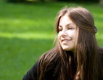 Bright girl in park Royalty Free Stock Image