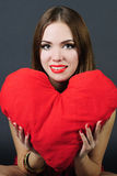 Bright girl with pillow heart in hand Royalty Free Stock Photo