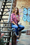 Bright girl in  plaid shirt talking on the phone. Bright girl in a plaid shirt talking on the phone, the youth of today Royalty Free Stock Image