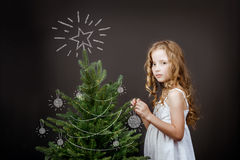 Bright girl stands near the Christmas tree concept Royalty Free Stock Photography