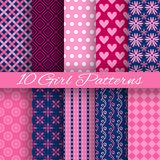 Bright girl vector seamless patterns (tiling). 10 Bright girl vector seamless patterns (tiling). Pink and blue colors royalty free illustration