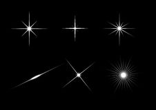 Bright glare. Stars, vector on a black background royalty free illustration