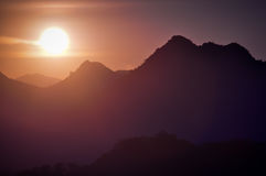 Bright Glare of Sunset silhouette mountains. In Laos Stock Photos