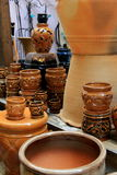 Bright glazes on clay planters arranged on wood tables Stock Photography