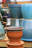 Bright glazes on clay planters Royalty Free Stock Photo
