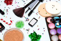Bright glistening New Year party make up cosmetics. Bright glistening New Year party make up. Cosmetics and accessories. Close up, selective focus royalty free stock photography