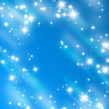 Bright glitters on a soft blue Royalty Free Stock Image