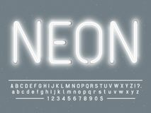 Bright glowing white neon sign characters. Vector font with glow light letters and numbers lamps. Bright glowing white neon sign characters. Vector font with stock illustration