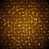 Bright gold flashes. On a brown background Stock Photos